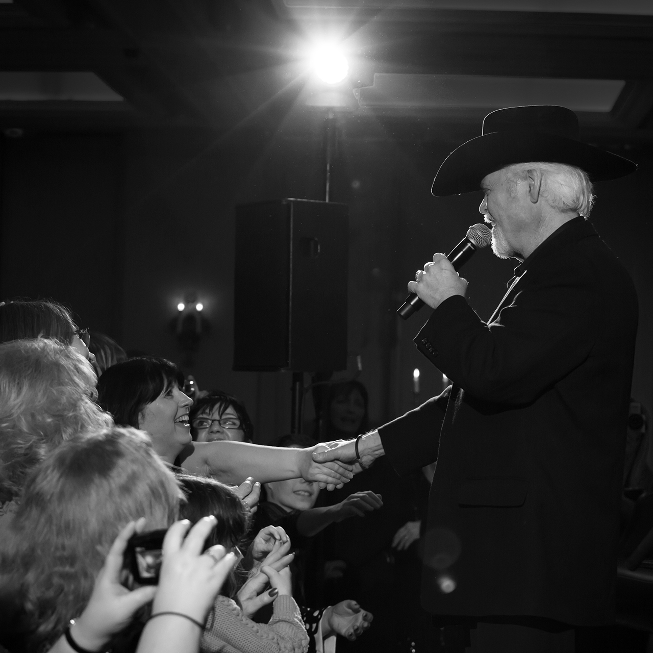 Merrill Osmond singing to fans
