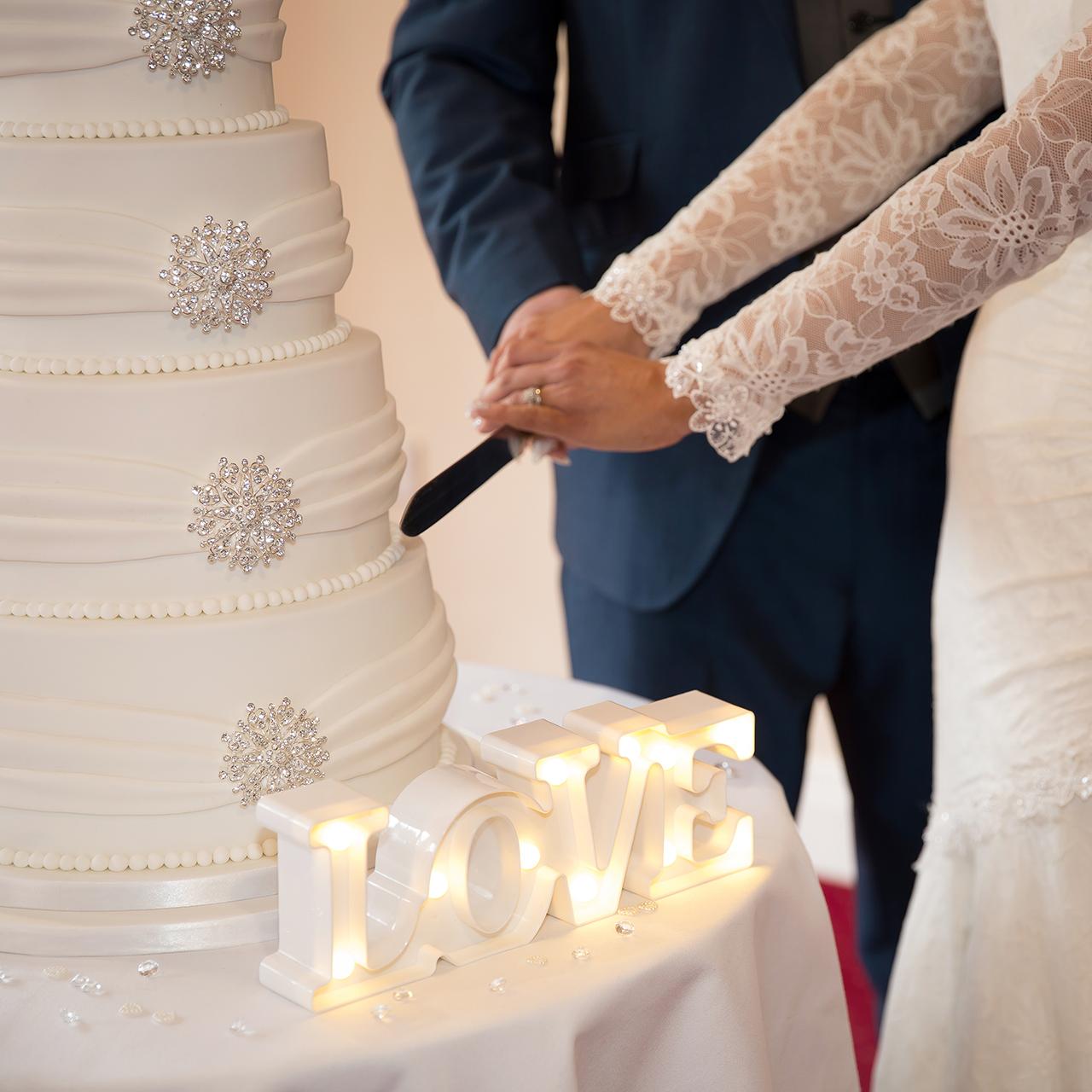 Traci Habergham Photography Wedding Cutting Cake